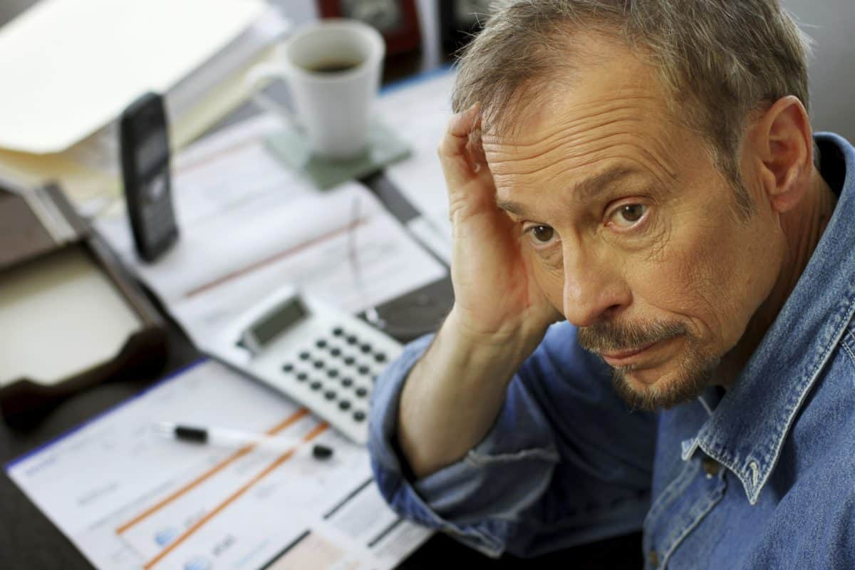 man dealing with stress, financial stress, credit stress,